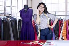 Fashion designer speaking on cellphone Royalty Free Stock Photos