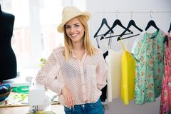 Fashion designer standing in workshop Royalty Free Stock Photo