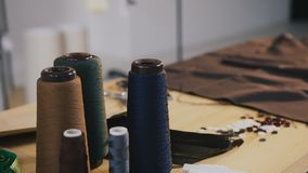 Fashion designer studio. Atelier. On the table in fashion atelier there are coils of thread, scissors, meter, tissue stock video footage