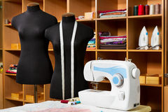 Fashion designer studio with dressmakers equipment. Fashion designer studio with dressmakers professional equipment: mannequin, cloth, sewing machine, irons Royalty Free Stock Photo