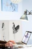 Fashion designer in studio. Royalty Free Stock Image