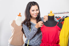 Fashion designer or Tailor working on a design or draft, measuri Royalty Free Stock Images