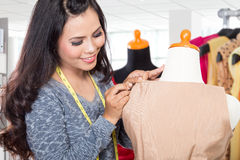 Fashion designer or Tailor working on a design or draft, measuri Stock Images