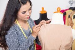Fashion designer or Tailor working on a design or draft, measuri Royalty Free Stock Photo