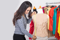 Fashion designer or Tailor working on a design or draft, measuri Royalty Free Stock Image
