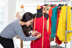 Fashion designer or Tailor working on a design or draft royalty free stock photography