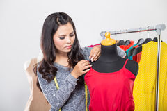 Fashion designer or Tailor working on a design or draft Stock Image