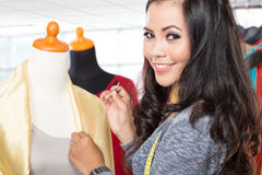 Fashion designer or Tailor working on a design or draft Stock Photos