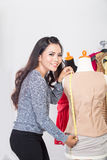 Fashion designer or Tailor working on a design or draft Stock Photography