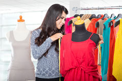 Fashion designer or Tailor working on a design or draft, she tak Royalty Free Stock Photo