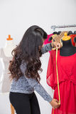 Fashion designer or Tailor working on a design or draft, she tak Royalty Free Stock Photography