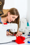 Fashion designer or tailor working in studio Stock Image