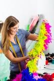 Fashion designer or tailor working in studio Royalty Free Stock Image