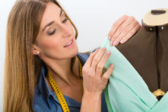 Fashion designer or tailor working in studio Stock Images