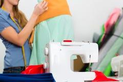Fashion designer or tailor working in studio Stock Photo