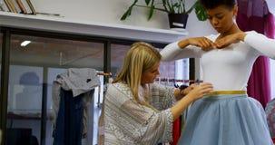 Fashion designer taking measurement of customer 4k. Fashion designer taking measurement of customer in fashion studio 4k stock video