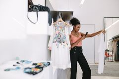Woman entrepreneur at work in her fashion boutique Stock Photos