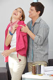 Fashion designer trying on clothes Stock Photography