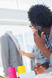 Fashion designer using his mobile phone Royalty Free Stock Images