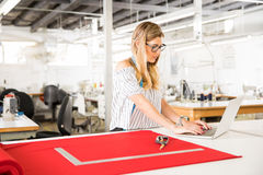 Fashion designer using a laptop stock image