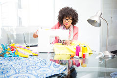Fashion designer using sewing machine Stock Photo
