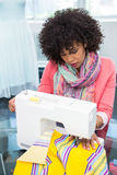 Fashion designer using sewing machine Royalty Free Stock Photo