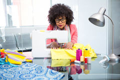Fashion designer using sewing machine Royalty Free Stock Images