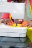 Fashion designer using sewing machine Stock Image
