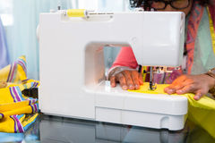 Fashion designer using sewing machine Royalty Free Stock Image