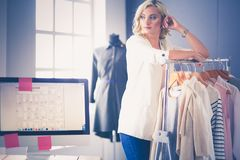 Fashion designer woman working on her designs in the studio. Royalty Free Stock Images