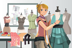 Fashion designer at work. A vector illustration of a fashion designer at work Royalty Free Stock Images