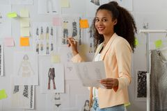 Fashion designer working on collection Stock Photos