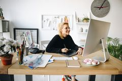 Fashion designer working with devices Stock Images
