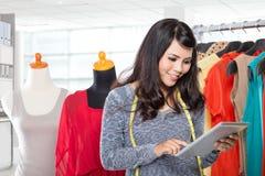 Fashion designer working on draft Stock Images