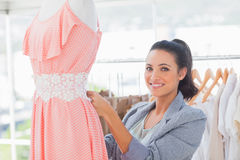 Fashion designer working on dress Royalty Free Stock Photography