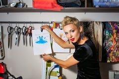 Fashion designer working with dummy Stock Image