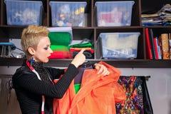 Fashion designer working with dummy Stock Photo