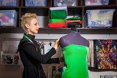 Fashion designer working with dummy Royalty Free Stock Image