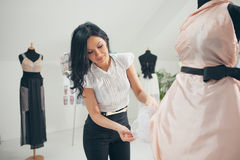 Fashion Designer Working at Her Studio Stock Photo