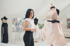 Fashion Designer Working at Her Studio Stock Images