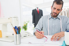 Fashion designer working on his designs in studio Royalty Free Stock Photo