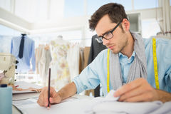 Fashion designer working on his designs Royalty Free Stock Photos