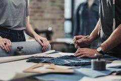 Fashion designer working in his studio royalty free stock photo