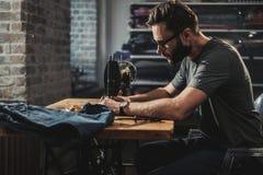 Fashion designer working in his studio.  royalty free stock photos