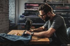 Fashion designer working in his studio.  royalty free stock images