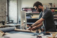 Fashion designer working in his studio.  royalty free stock photography