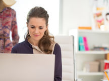 Fashion designer working on laptop in office Stock Photography