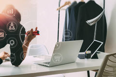 Fashion designer working with mobile phone and using laptop with. Digital tablet computer in modern studio with VR icon diagram Royalty Free Stock Image