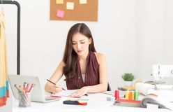 Fashion designer working in the office royalty free stock photo