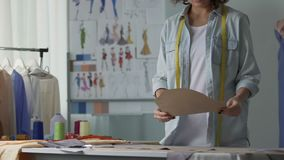 Fashion designer working patterns in her studio, clothing industry, business. Stock footage stock footage